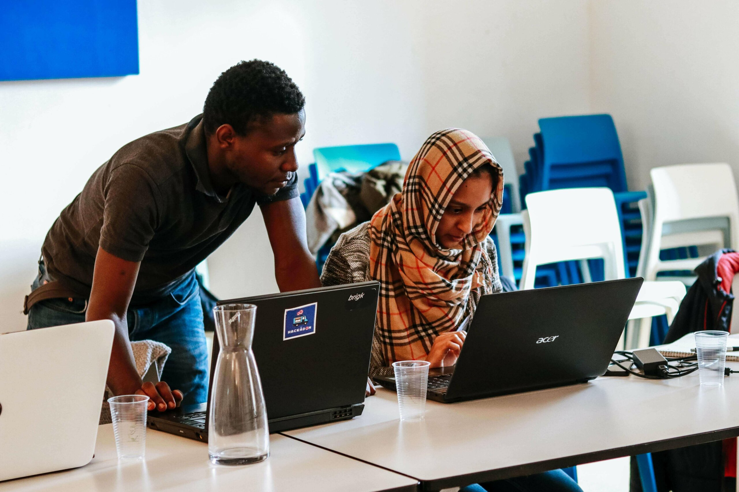 Two refugee students are using Kiron's online education platform